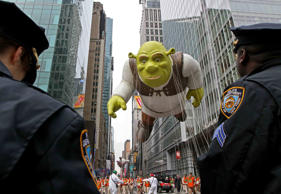 Members of the New York Police Department stand by as the Shrek balloon makes its way across 42nd Street during the Macy's Thanksgiving Day Parade on Thursday, Nov. 25, 2010 in New York. Tina Fineberg/AP