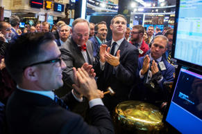 Chris Volk, CEO of STORE Capital, rings a ceremonial bell on the floor of the New York Stock Exchange shortly after the opening bell in New York Nov. 18, 2014.