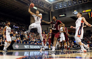 Gonzaga Bulldogs forward Angel Nunez (2) puts up a shot against Saint Joseph's Hawks forward Isaiah Miles (15) during the second half at McCarthey Athletic Center on Nov. 19, 2014 in Spokane, Wash.