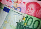 File photo of a 100 Euro banknote with a 100 yuan banknote.