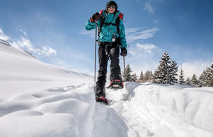Woman snowshoeing in the back country.