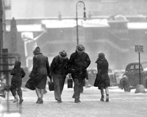Greetings from Jack Frost howled into town on a 50 m.p.h. gale. Here are some of New Yorkers battling the snowstorm. 14 Feb 1940