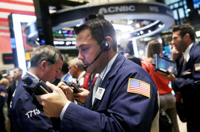 Traders work on the floor of the New York Stock Exchange (NYSE) on November 18, ...