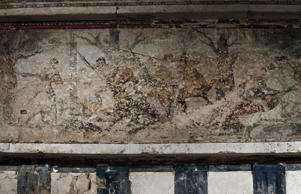 A fresco painting of a hunt tops the facade of a tomb believed to belong to the ancient Greek King Philip II of Macedon at Vergina museum, northern Greece.