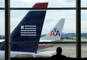 An American Airlines plane and a US Airways plane at parked at Washington's Ronald Reagan National Airport.