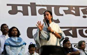 File: West Bengal state Chief Minister and Trinamool Congress party (TMC) chief Mamata Banerjee, center, addresses supporters as she leads a protest against the federal government in Kolkata, India