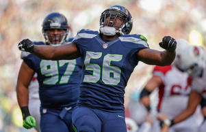 Defensive end Cliff Avril #56 of the Seattle Seahawks celebrates after a sack against the Arizona Cardinals at CenturyLink Field on November 23, 2014 in Seattle, Washington.