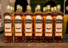 A row of Bushmills Irish Whiskey bottles are on display