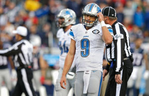 Matthew Stafford #9 of the Detroit Lions reacts during the fourth quarter against the New England Patriots at Gillette Stadium on November 23, 2014 in Foxboro, Massachusetts.
