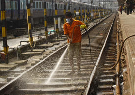 File: A worker cleans a railway track at a railway station in Kolkata