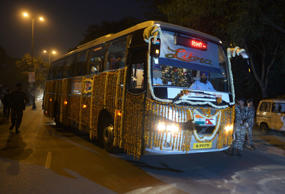 A passenger bus drives after it was flagged-off during the opening of a new bus route between India's capital and Nepal in New Delhi on November 25, 2014.