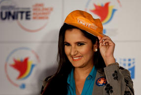 Indian tennis player Sania Mirza adjusts the cap presented to her after she was announced United Nations Women's goodwill ambassador for the South Asian region as she joined the campaign to end violence and against women and raise awareness about gender equality in New Delhi, India, Tuesday, Nov. 25, 2014.