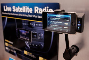 An Apple iPhone is shown in a XM Skydock at the Sirius Satellite Radio booth during 2010 International CES in Las Vegas
