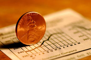 Photo of a penny on a growth chart. Shallow dof, focus on the penny. Save your pennies and invest in the future.