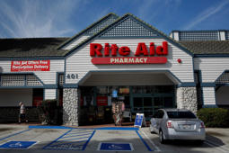 A car sits parked outside of a Rite Aid Corp. store in Redondo Beach, California, U.S., on Wednesday, April 9, 2014. Rite Aid Corp. is scheduled to release earnings figures on April 10.