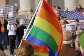 Supporters of Arkansas' law banning same sex marriage hold a rally on the steps of the state Capitol in Little Rock, Ark., on Wednesday as opponents of the ban carry flags and shout.