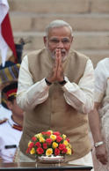 File: Narendra Modi greets attendees moments before taking the oath of office to be sworn in as India's Prime Minister in New Delhi on May 26, 2014.