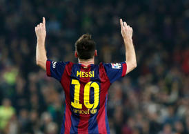 File: Barcelona's Lionel Messi celebrates his goal against Sevilla during their Spanish first division soccer match at Nou Camp stadium in Barcelona November 22, 2014.