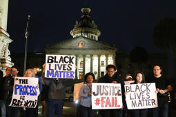 File: A rally at the South Carolina State House, in Columbia, S.C., in the wake of the grand jury decision not to indict officer Darren Wilson in the shooting death of Ferguson, Mo., teen Michael Brown, on Tuesday, Nov. 25, 2014. (Kim Kim Foster/The State/MCT)