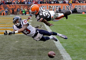 Cleveland Browns defensive back K'Waun Williams (36) breaks up a pass in the end zone against Houston Texans wide receiver Damaris Johnson in the first quarter of an NFL football game Sunday, Nov. 16, 2014, in Cleveland. (AP Photo/Tony Dejak)