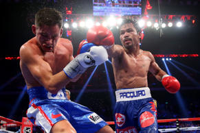 MACAU - NOVEMBER 23:  Manny Pacquiao of the Philippines punches Chris Algieri of the United States during the WBO world welterweight title at The Venetian on November 23, 2014 in Macau, Macau.  (Photo by Chris Hyde/Getty Images)