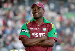 West Indies captain Brian Lara smiles while watching the fans cheering him after playing his last international cricket match in the Super 8s round against England of the Cricket World Cup at the Kensington Oval in Bridgetown, Barbados, Saturday, April 21, 2007.