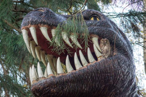 The Tawny Owl nesting in the mouth of the Tyrannosaurus rex smodel
