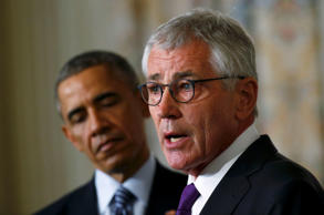 U.S. President Barack Obama listens to Defense Secretary Chuck Hagel after the president announced Hagel's resignation at the White House in Washington, November 24, 2014.