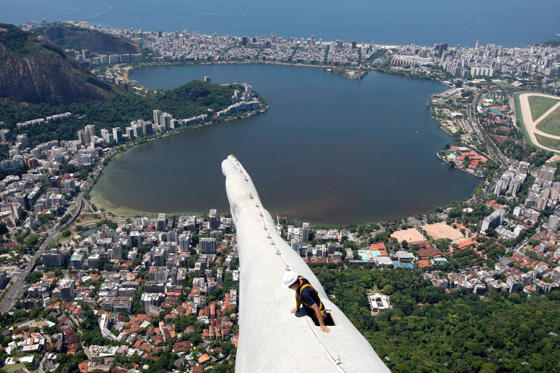 A worker inspects the Christ the Redeemer statue which was damaged during lightning storms in Rio de Janeiro on January 21.