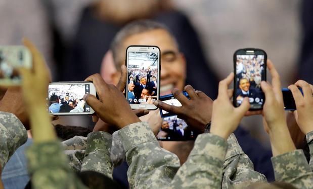 US soldiers use their smartphones take pictures of President Barack Obama after delivering a speech at American military base Yongsan Garrison in Seoul, South Korea on April 26.