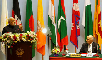 File: Afghanistan President Ashraf Ghani listens to Indian Prime Minister Narendra Modi during the 18th summit of the South Asian Association for Regional Cooperation (SAARC) in Katmandu, Nepal