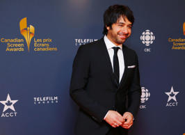 CBC personality Jian Ghomeshi arrives on the red carpet at the 2014 Canadian Screen awards in Toronto, March 9, 2014.