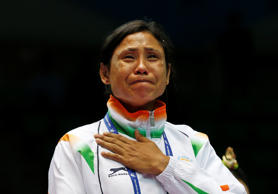 File: India's L. Sarita Devi cries after she refused her bronze medal during the medal ceremony for the women's light 60-kilogram division boxing at the 17th Asian Games in Incheon, South Korea