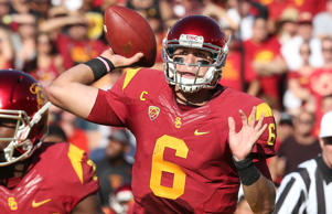 Quarterback Cody Kessler #6 of the USC Trojans throws a seven yard touchdown pass to JuJu smith in the first quarter against the Colorado Buffaloes at Los Angeles Memorial Coliseum on Oct. 18, 2014 in Los Angeles.
