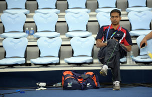 Indian badminton coach Pullela Gopichand watches during a training session at Gyeyang gymnasium during the 2014 Asian Games in Incheon on September 18, 2014.
