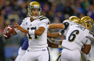 Quarterback Brett Hundley #17 of the UCLA Bruins passes in the first half against the Washington Huskies on November 8, 2014 at Husky Stadium in Seattle, Washington.