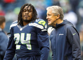 Seattle Seahawks head coach Pete Carroll talks with Seattle Seahawks running back Marshawn Lynch (24) during pre game warmups against the Arizona Cardinals at CenturyLink Field.