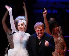 "File: Singers Lady Gaga, Elton John, and Dame Shirley Bassey, sing ""Don't Stop Believing"" during the 21st birthday celebration of the Rainforest Fund at Carnegie Hall in New York."