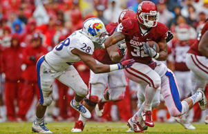 Oklahoma Sooners running back Samaje Perine (32) runs for a touchdown past Kansas Jayhawks linebacker Courtney Arnick (28) during the first half at Gaylord Family - Oklahoma Memorial Stadium on Nov. 22, 2014 in Norman, Okla.
