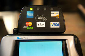 A card payment reader allowing customers to swipe credit cards, debite cards, PayPass, Apple Pay and other payment methods is displayed at the cash register of a Whole Foods in New York City on Oct. 20.