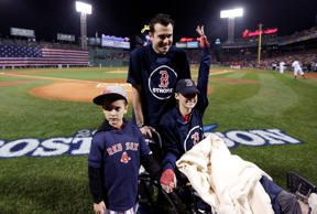 Surviving Boston Marathon bombing victims Peter DiMartino, left, of Rochester, N.Y., and Rebekah Gregory, right, of Richmond, Texas, were honored along with Rebekah's son, Noah, at a Boston Red Sox playoff game Oct. 12, 2013.