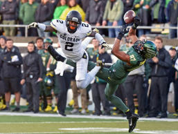 Oregon wide receiver Darren Carrington (87) catches the ball as Colorado cornerback Kenneth Crawley (2) defends during the second quarter of an NCAA college football game on Nov. 22, in Eugene, Ore.