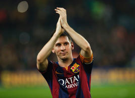 File: Barcelona's Lionel Messi celebrates at the end of their Spanish first division soccer match against Sevilla at Nou Camp stadium in Barcelona November 22, 2014. Messi set a La Liga scoring record of 253 goals when he netted a hat-trick in Saturday's 5-1 win at home to Sevilla.