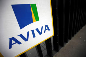 A logo sits on a sign outside the headquarters of Aviva Plc in London, U.K.