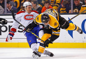 Montreal Canadiens' P.A. Parenteau, left, is checked by Boston Bruins' Patrice Bergeron during the first period of an NHL hockey game in Boston on Nov. 22.