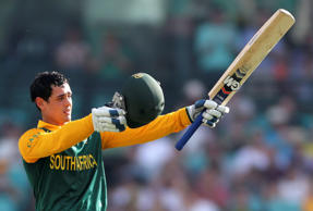 South Africa's Quinton de Kock points his bat towards his team as he celebrates hitting a century during their One Day International cricket match against Australia's in Sydney, Australia, Sunday, Nov. 23, 2014.