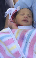 This photo released by New South Wales Police shows a newborn baby who was found Sunday, Nov. 23, 2014 abandoned in a drain in the Sydney suburb of Quakers Hill, Australia.