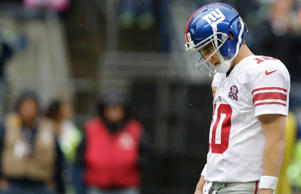 New York Giants quarterback Eli Manning walks off the field after a play against the Seattle Seahawks during an NFL football game, Sunday, Nov. 9, 2014, in Seattle.