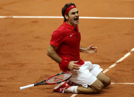 Switzerland's Roger Federer reacts after defeating France's Richard Gasquet during the Davis Cup final at the Pierre Mauroy stadium in Lille, northern France, Sunday, Nov. 23, 2014.