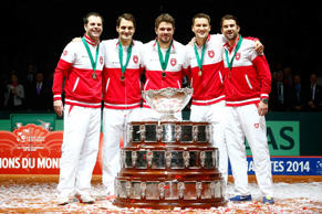 Roger Federer of Switzerland, Stanislas Wawrinka of Switzerland , Marco Chiudinelli of Switzerland, Michael Lammer of Switzerland and Captain Severin Luthi of Switzerland celebrate winning the Davis Cup against France during day three of the Davis Cup Tennis Final between France and Switzerland at the Stade Pierre Mauroy on November 23, 2014 in Lille, France.
